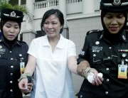 Yim Pek Ha being lead away from court in Malaysia where she was sentenced to 18-years for abusing her Indonesian maid