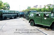 Signs of an army in retreat. Abandoned and disabled Thai Army vehicles in disarray on Pink lao Bridge.